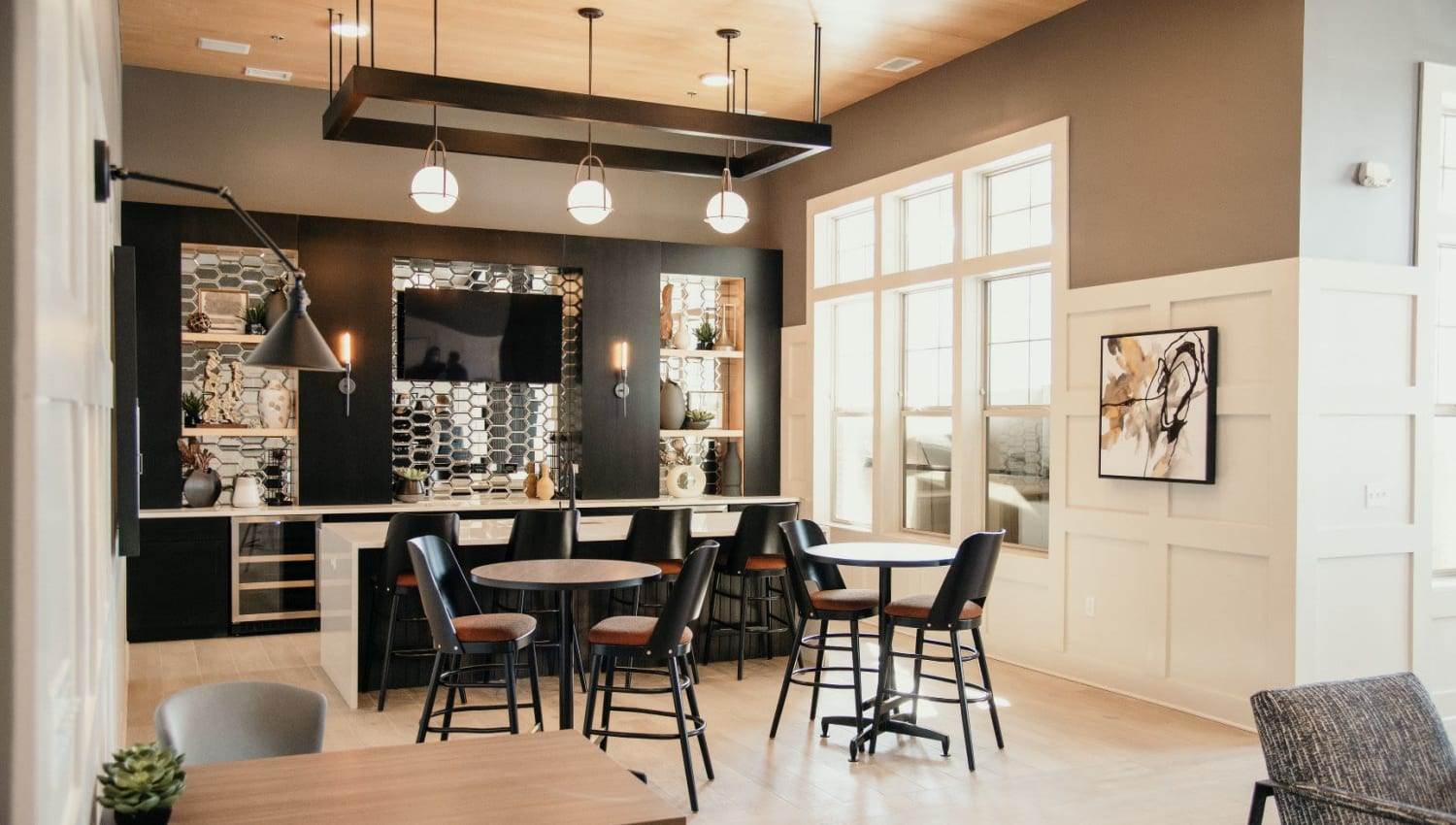 Club room kitchen and dining area at The 450 in Lombard, Illinois