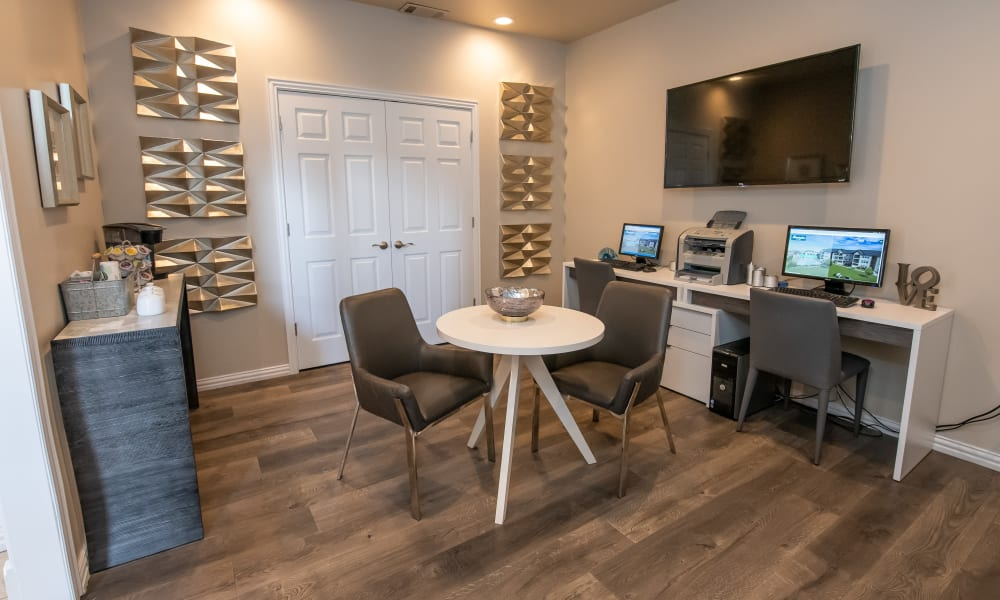 Business center with TV and coffee at Remington Apartments in Amarillo, Texas