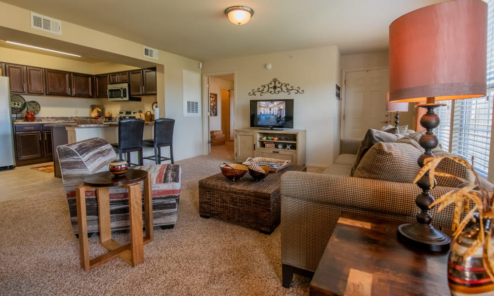 Large living room with open kitchen at Park at Tuscany in Oklahoma City, Oklahoma