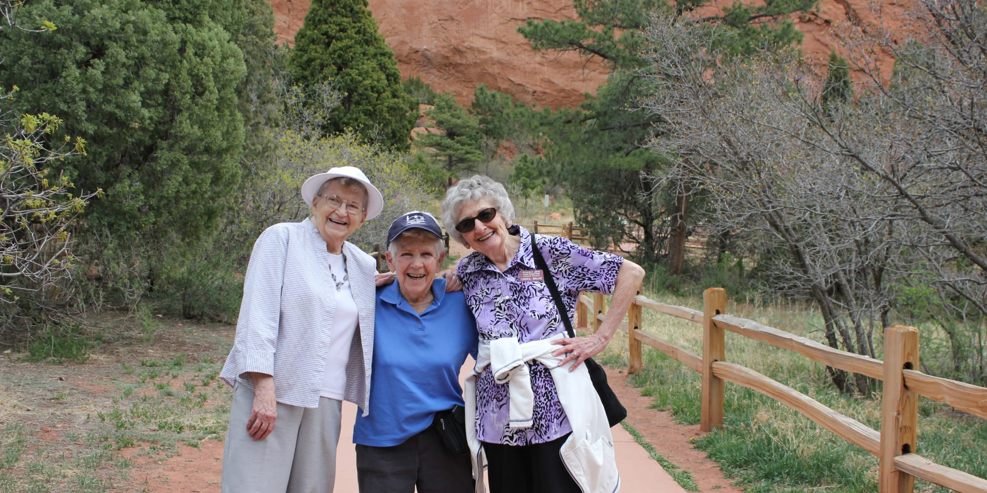 Three residents from Summit Glen in Colorado Springs, Colorado going for a hike