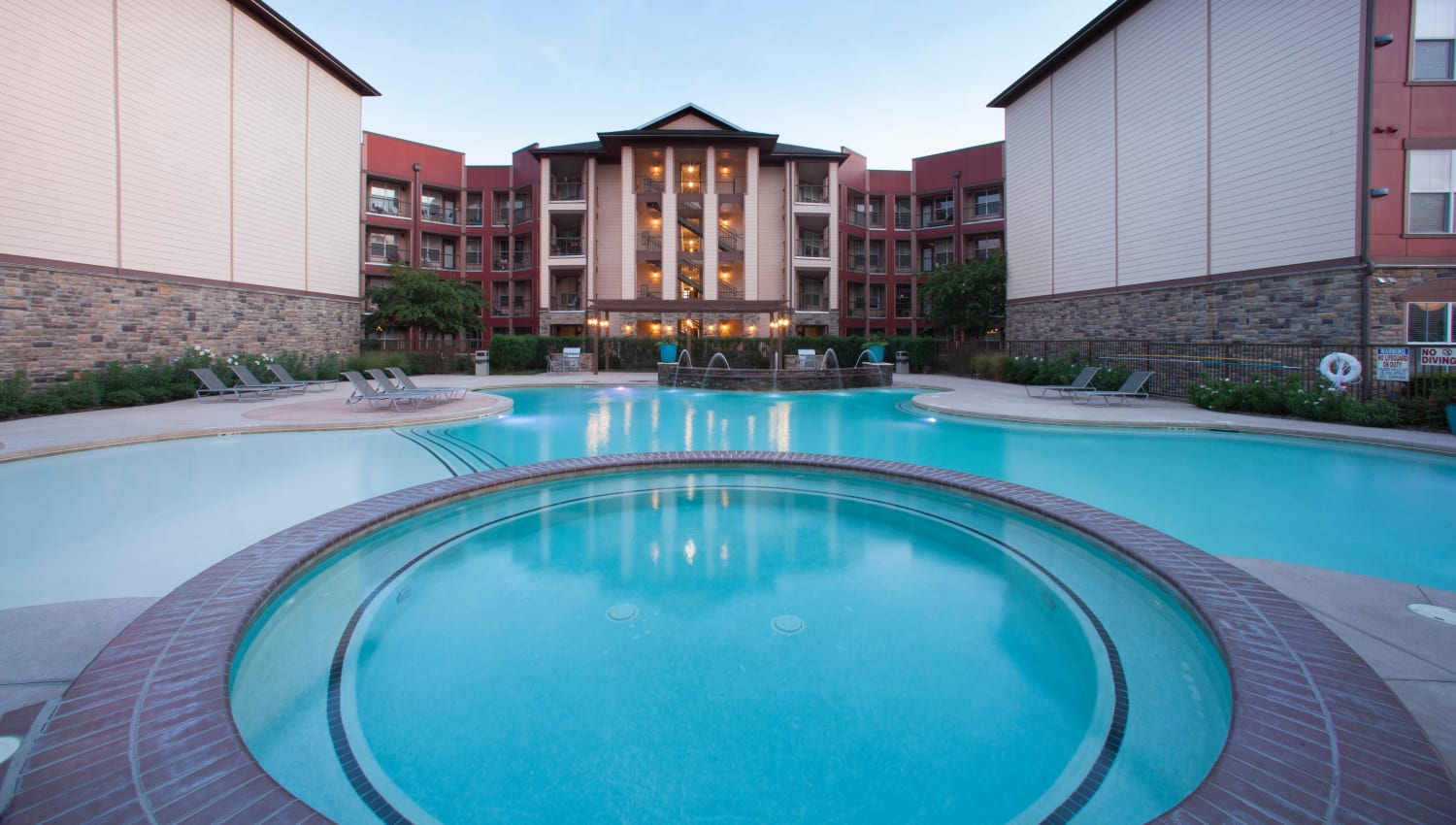 Dusk at the spa and pool area at Olympus Katy Ranch in Katy, Texas
