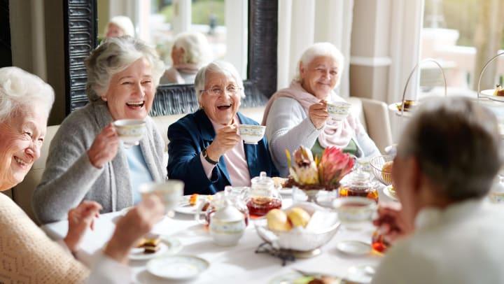 Group of senior women having tea.