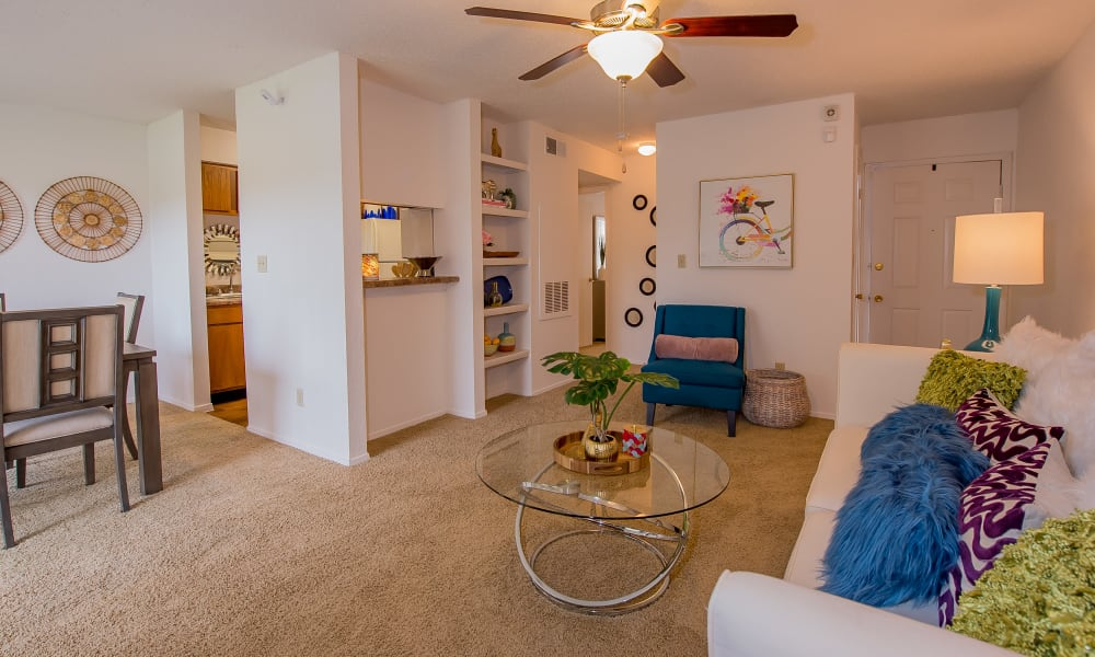 Open living room and dining room with built-in shelves at Windsail Apartments in Tulsa, Oklahoma