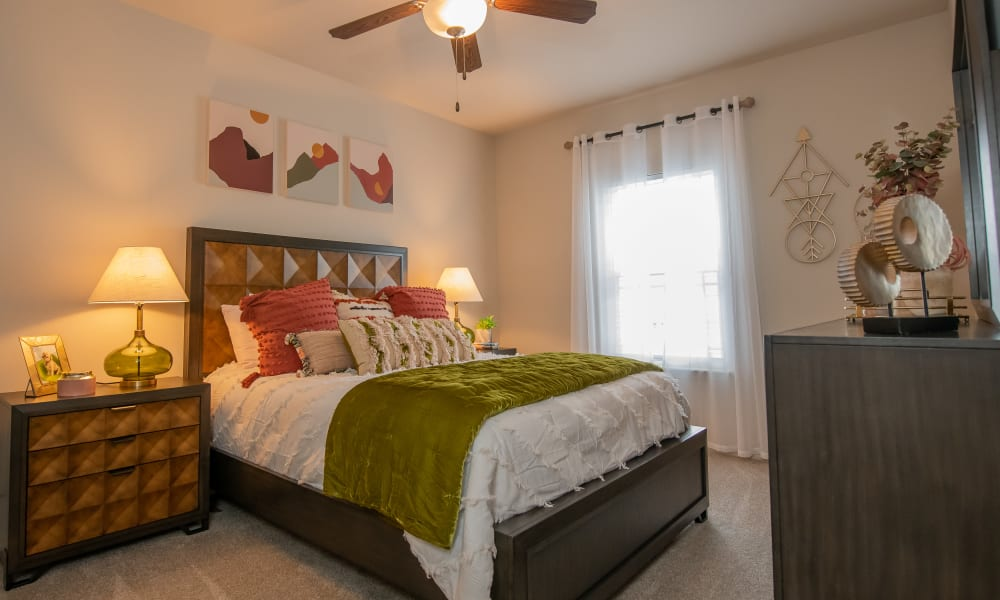Loft apartment bedroom at Bend at New Road Apartments in Waco, Texas