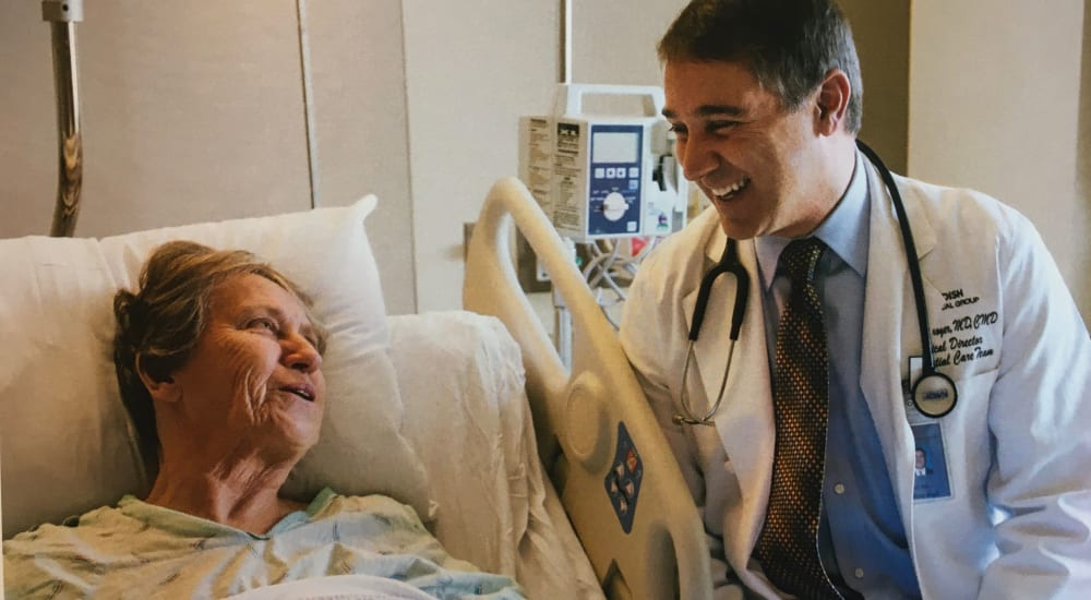 A doctor talking to a resident at Mission Healthcare at Bellevue in Bellevue, Washington.