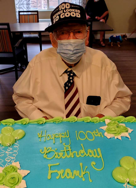 Frank enjoys his 100th birthday cake!