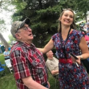 Resident Frank with Polka star Mollie B at his Dare to Dream event near Prairie Hills in Independence, Iowa