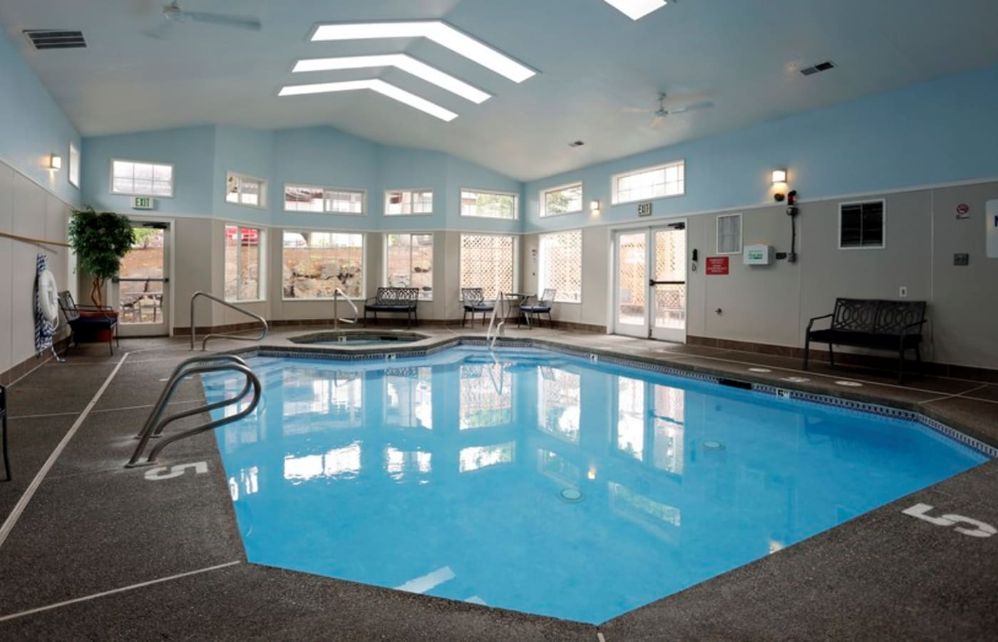Beautiful indoor swimming pool area at Discovery Landing Apartment Homes in Burien, WA