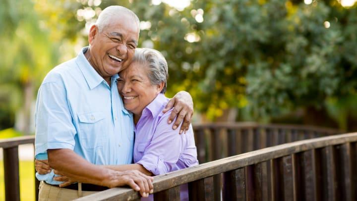 Senior Couple Smiling on a Bridge