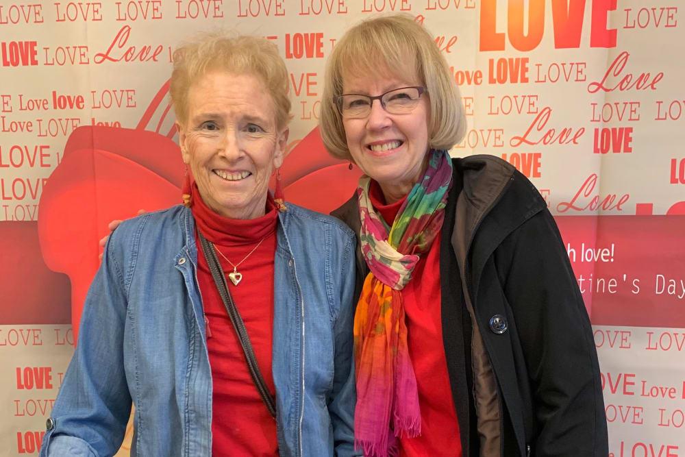 Senior woman and daughter smiling