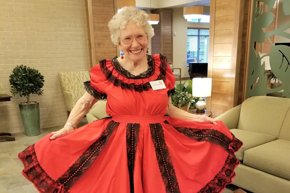 Resident showing off her dancing dress at Merrill Gardens at Burien in Burien, Washington