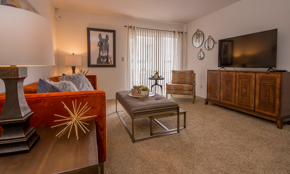 Spacious living room with patio entry at Windsail Apartments in Tulsa, Oklahoma