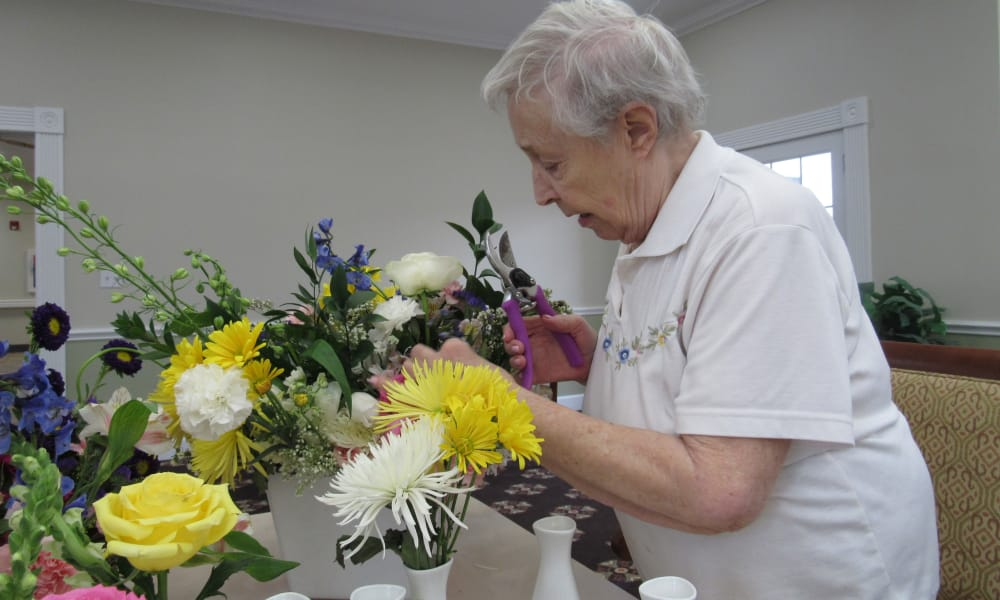 senior resident making some flower arrangements