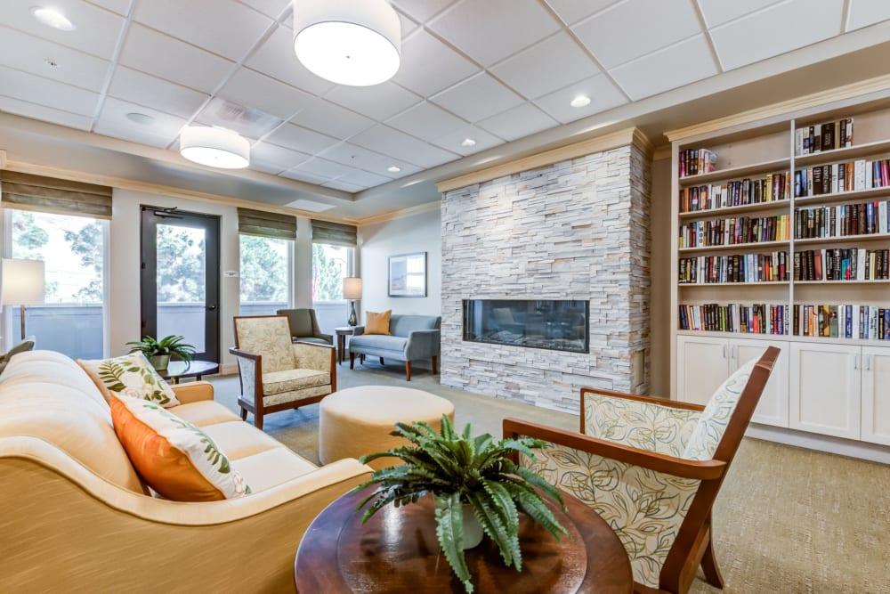 comfortable fireplace seating with bookshelf