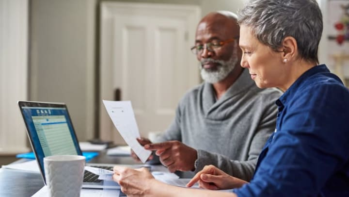 Couple financial planning on lap top