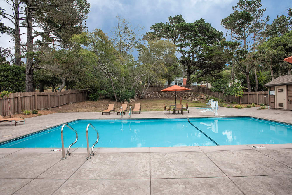 Resort-style swimming pool at Seventeen Mile Drive Village Apartment Homes in Pacific Grove, California
