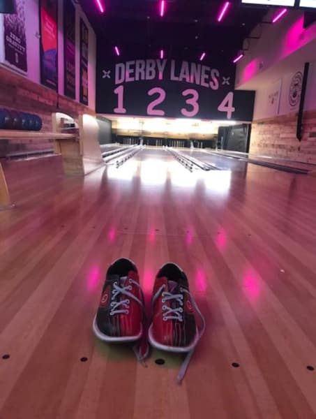 A pair of bowling shoes on a bowling lane
