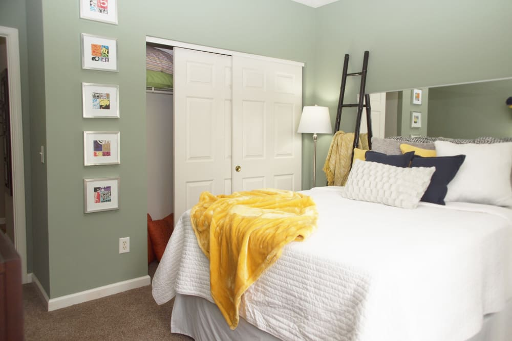 Bedroom with sliding closet doors at Waterford Place in Loveland, Ohio
