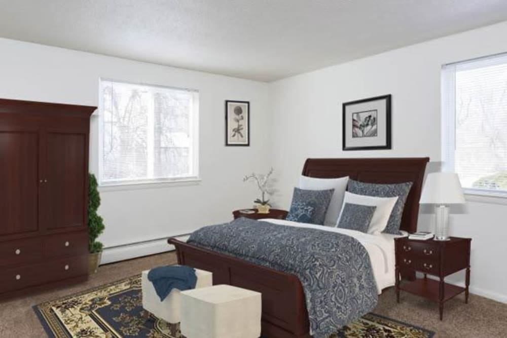 Luxury bedroom at Perinton Manor Apartments in Fairport, New York