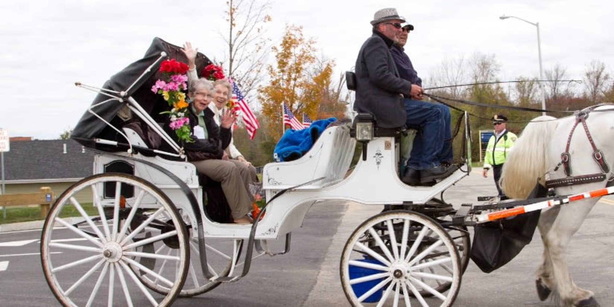 Two residents from Meadowlark Estates Gracious Retirement Living in Lawrence, Kansas in a horse drawn carriage
