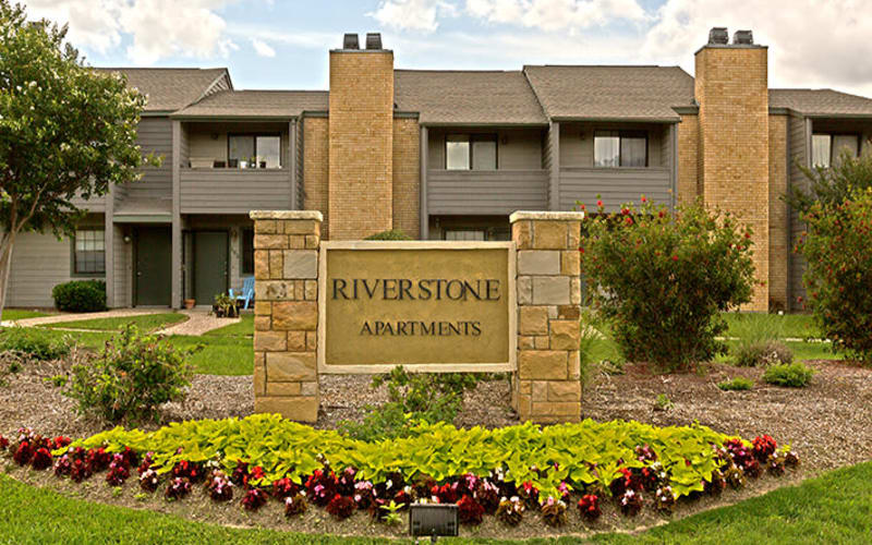 Exterior sign at Riverstone Apartments in Bryan, Texas