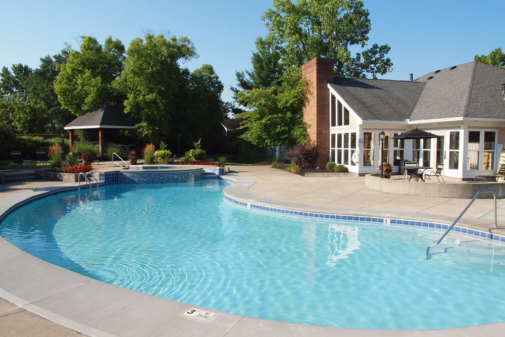 Outdoor pool and clubhouse at Fox Chase Apartments in Cincinnati, Ohio