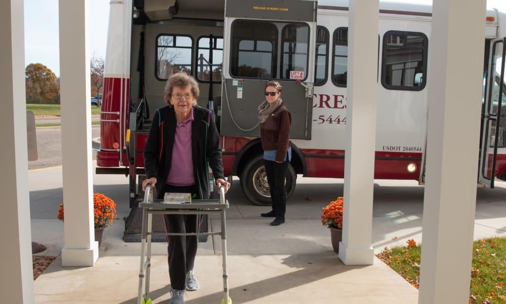 Smiling resident getting off the shuttle at Deer Crest Senior Living in Red Wing, Minnesota