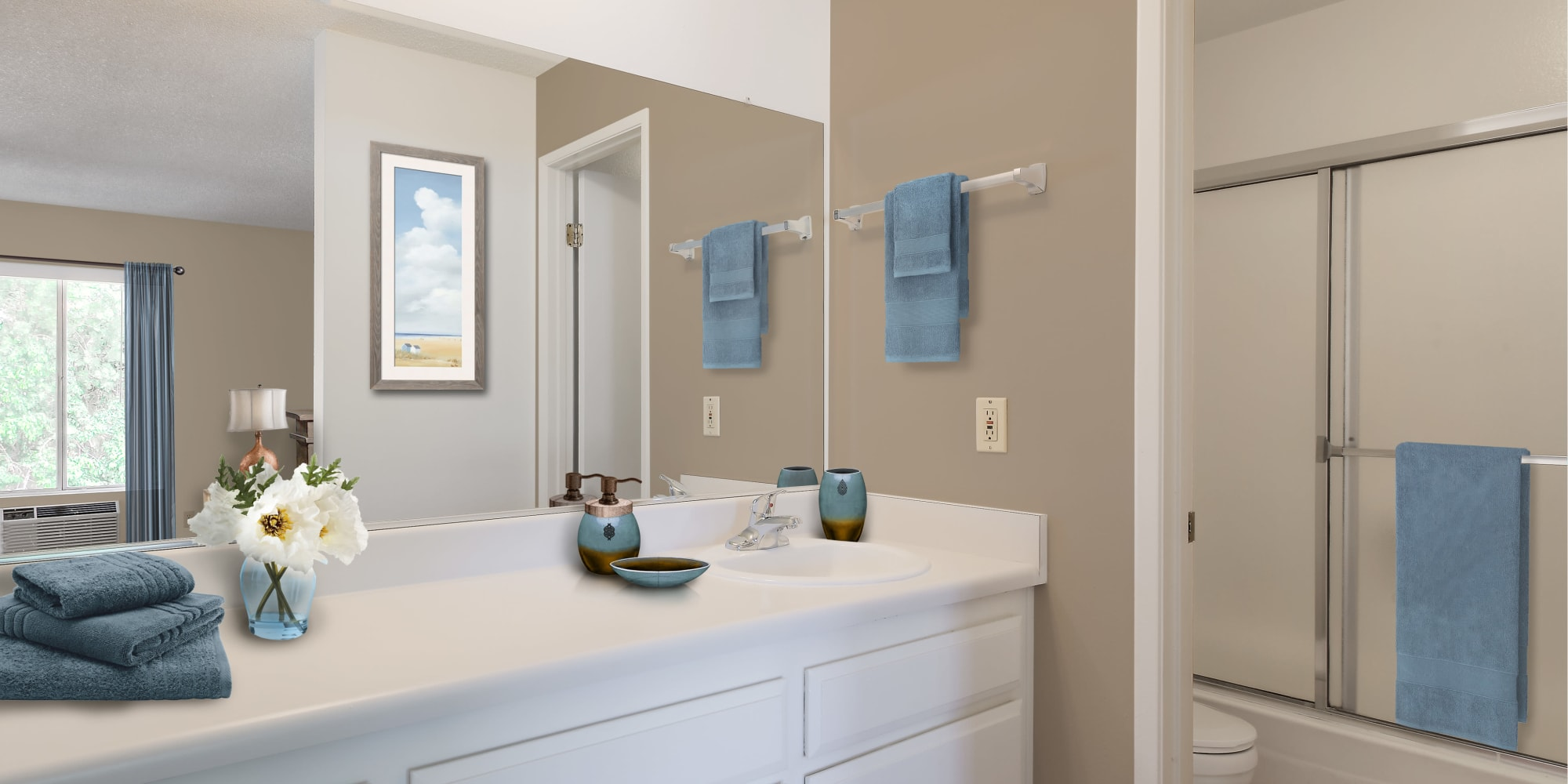 Vanity and shower in a model home's bathroom at Village Pointe in Northridge, California