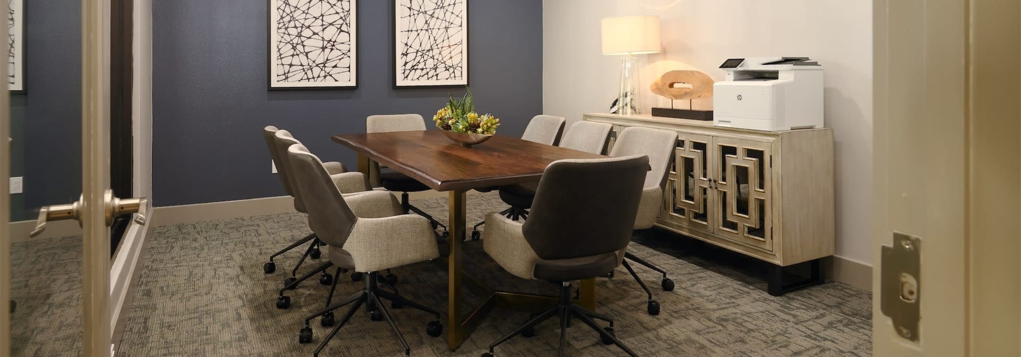 Conference table for residents to use at Seville Uptown in Dallas, Texas