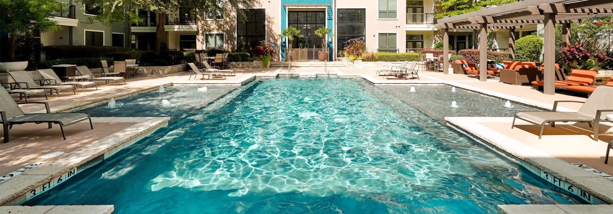 Resort-style swimming pool at Seville Uptown in Dallas, Texas