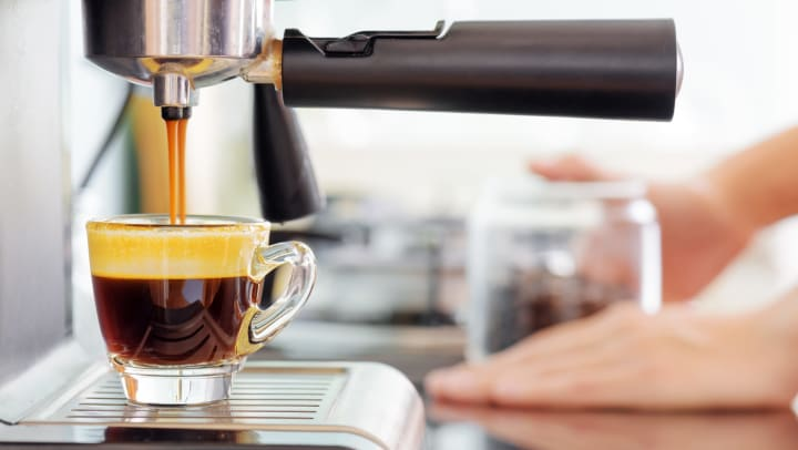 Espresso coffee machine in kitchen.