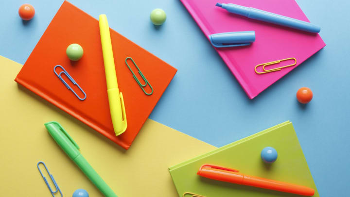 Colorful stationery with paper clips and markers