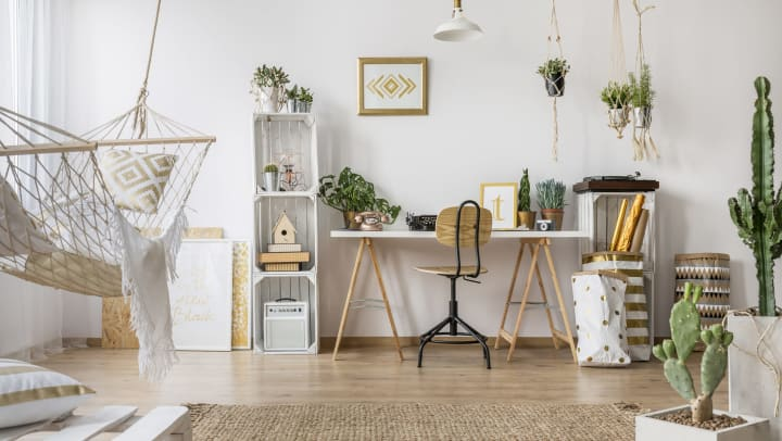 Apartment with stylish wood-style flooring, hammock, rug, desk, houseplants, and accessories