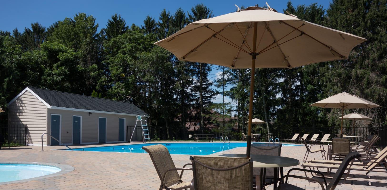 Pool deck and patio umbrella at Bridle Path Apartments in Bethlehem, Pennsylvania