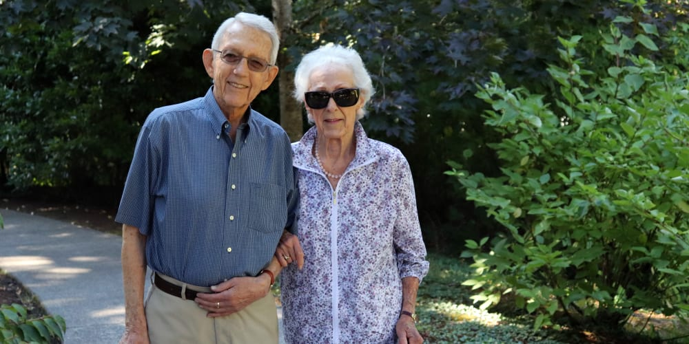 Resident couple walking around the grounds at The Springs at Carman Oaks in Lake Oswego, Oregon