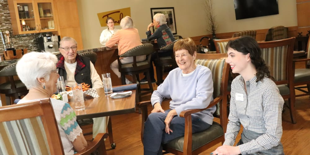 Residents at Fancho's enjoying their meal and talking with their server at The Springs at Greer Gardens in Eugene, Oregon