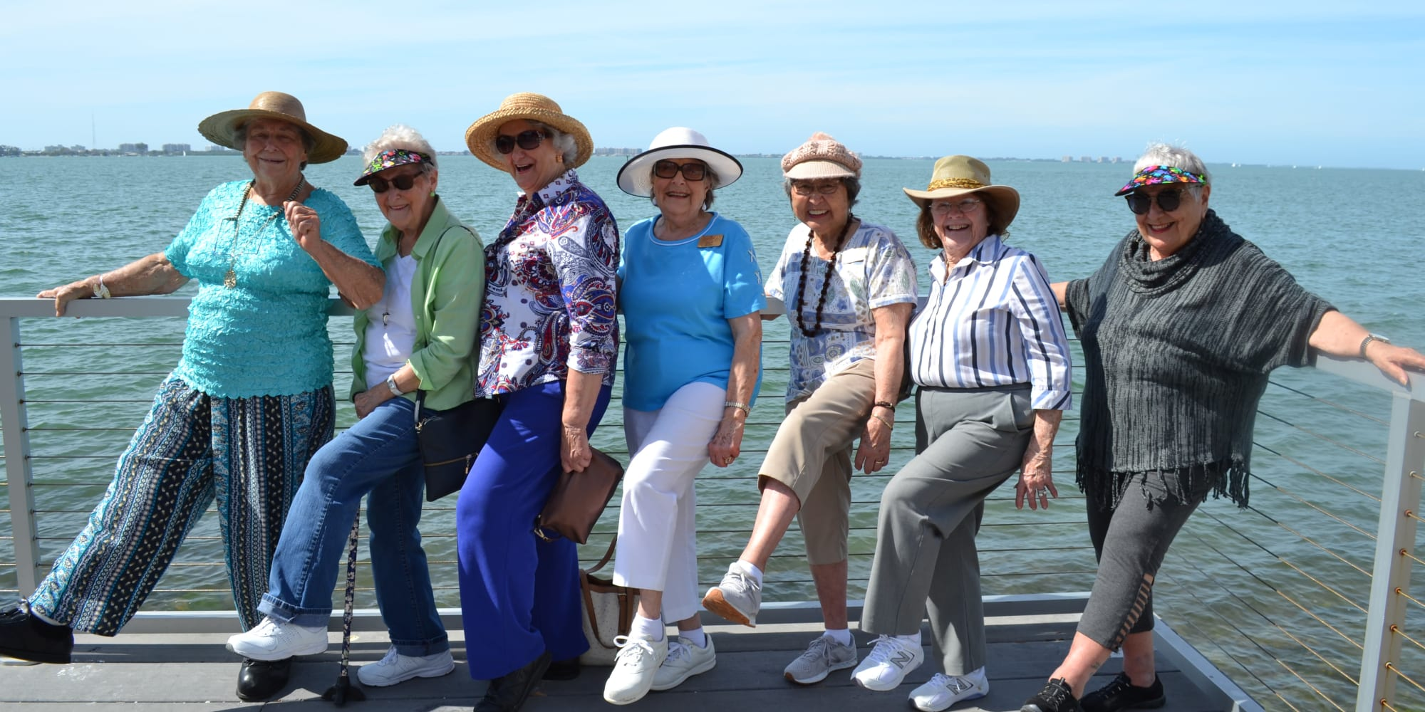 Residents from The Bradley Gracious Retirement Living in Kanata, Ontario posing by the waterfront