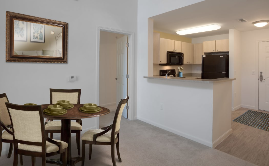 Dining area and adjacent kitchen in model home at Prynne Hills in Canton, MA