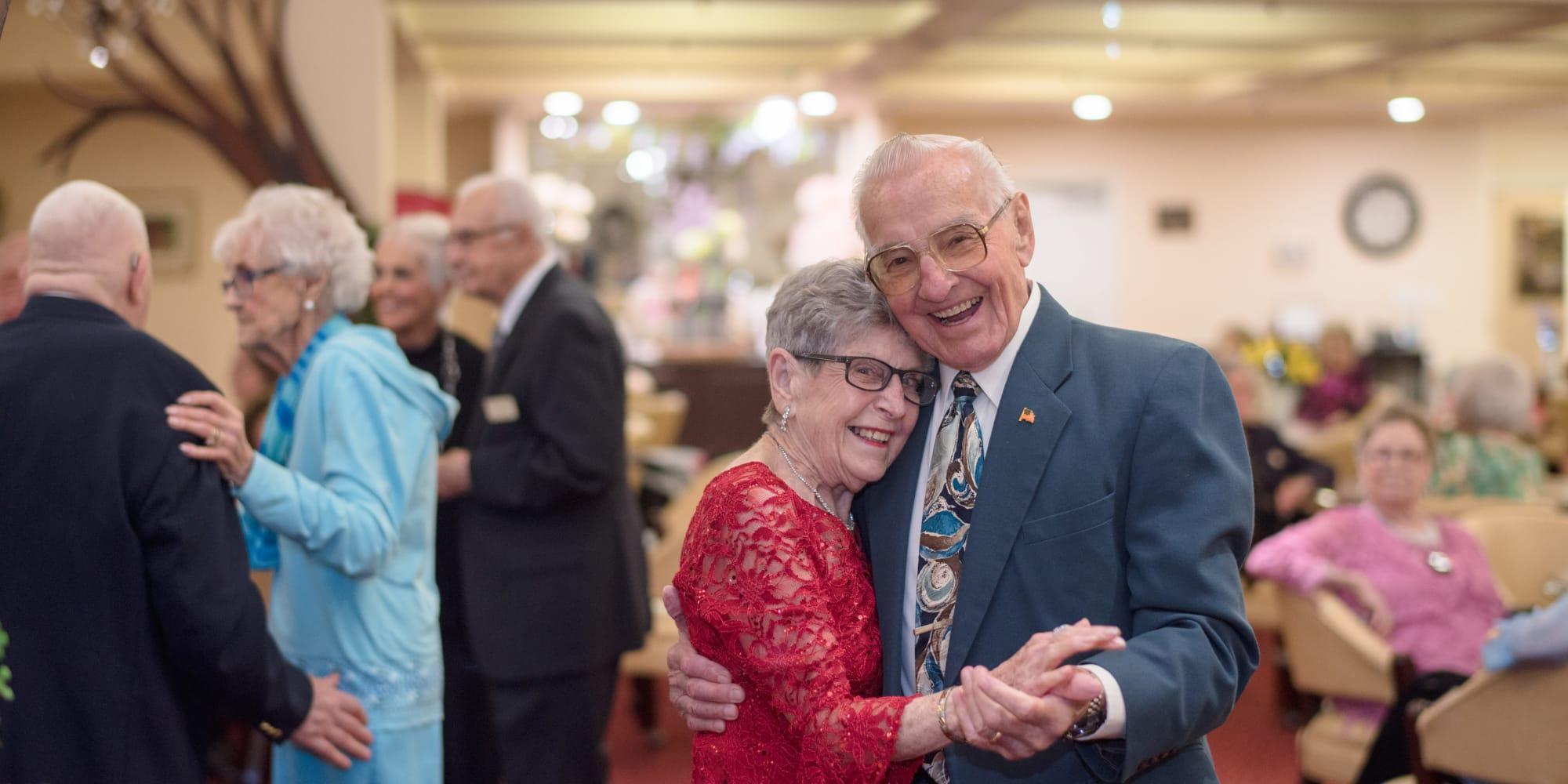 A happy couple dancing at Liberty Heights Gracious Retirement Living in Rockwall, Texas