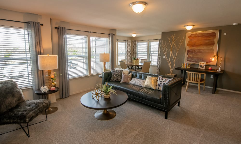 Large, bright living room with dining room and office nook at Cottages at Crestview in Wichita, Kansas
