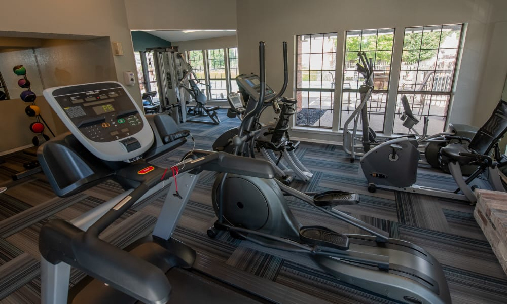 Fitness center with free weights and machines at Creekwood Apartments in Tulsa, Oklahoma