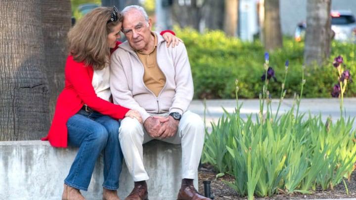 Senior man sitting and talking to his daughter