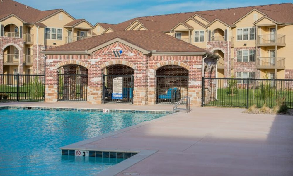 A gated community pool at Watercress Apartments in Maize, Kansas
