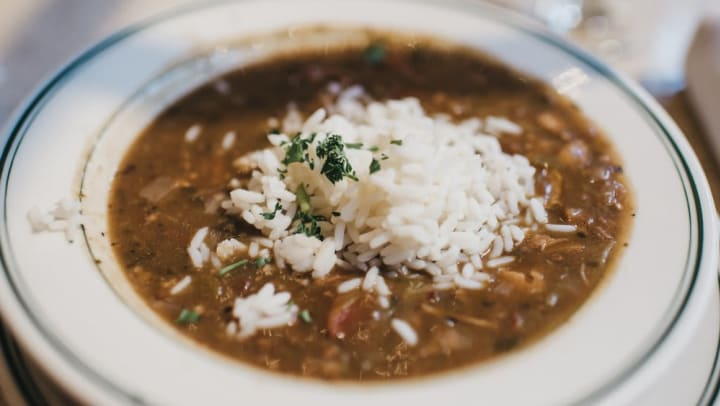 Delicious bowl of gumbo topped with rice at a locals favorite restaurant near The Slate in Savannah, Georgia