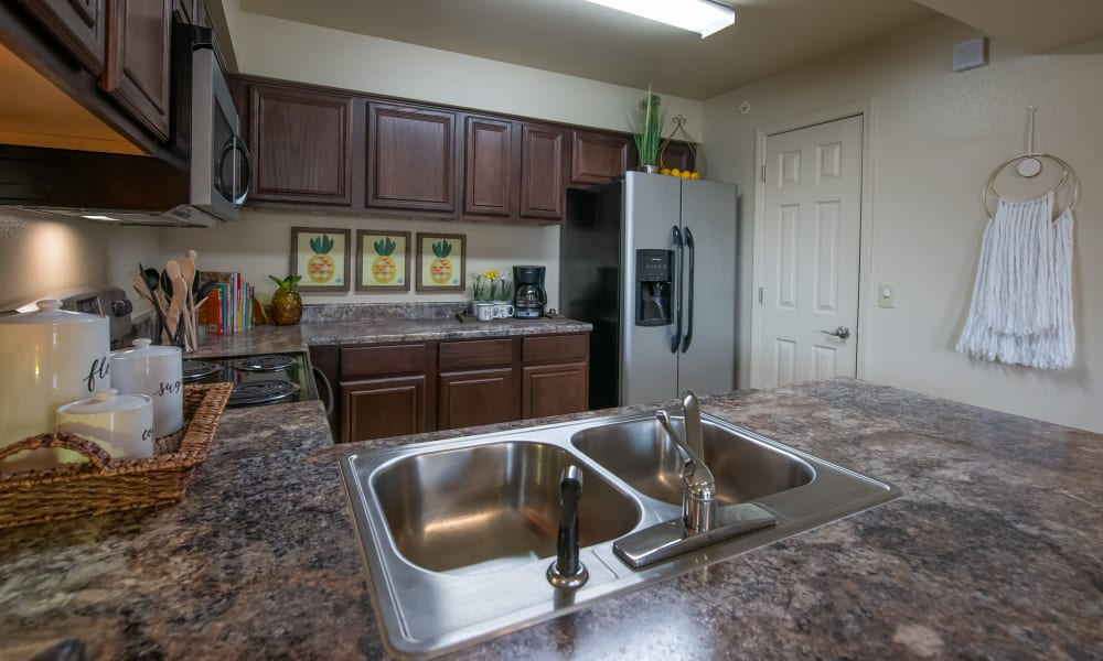 Kitchen with pantry at Park at Mission Hills in Broken Arrow, Oklahoma