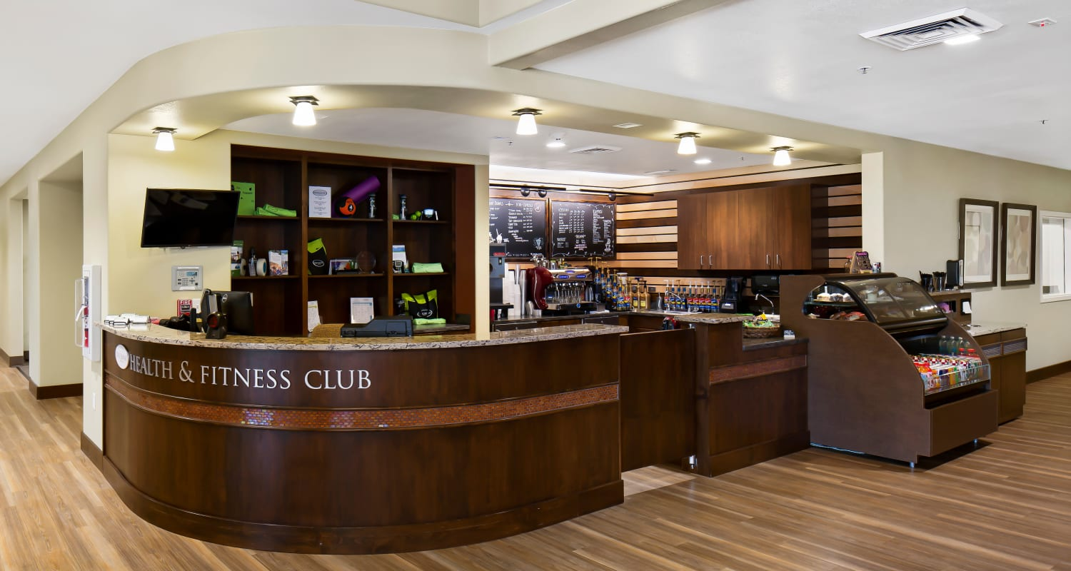 The front desk and bistro at Touchmark at Meadow Lake Village Health & Fitness Club in Meridian, Idaho