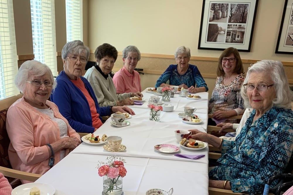 group photo of residents eating desert