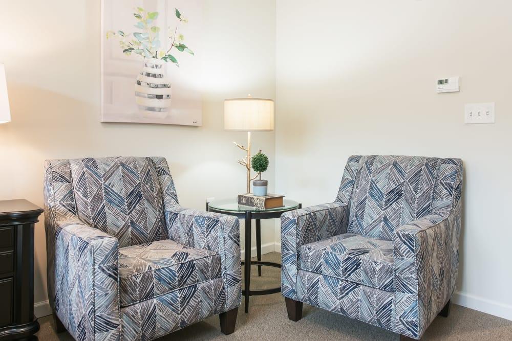 Love seats in a studio apartment at The Mansions at Alpharetta in Alpharetta, Georgia