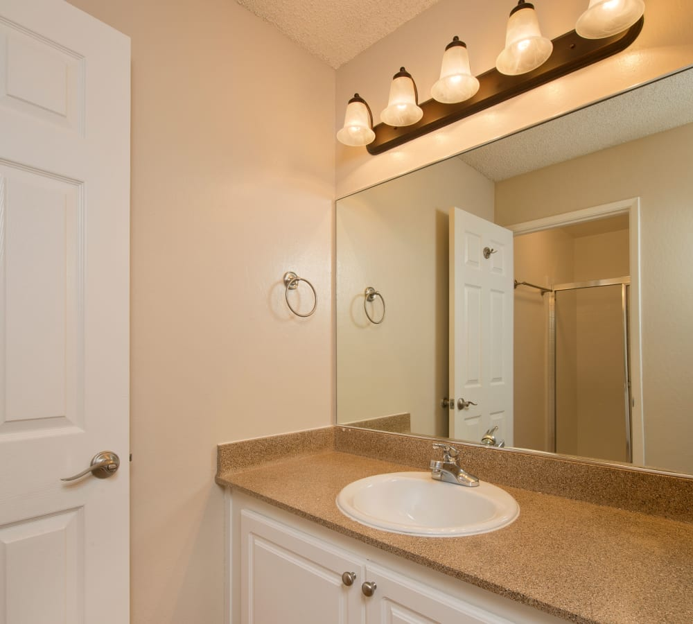 Kitchen with a large vanity mirror at Flora Condominium Rentals in Walnut Creek, California