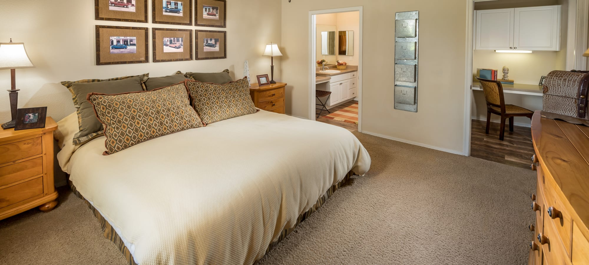 Well-lit master bedroom with an en suite bathroom in a model home at Stone Oaks in Chandler, Arizona